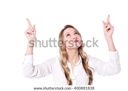 Young woman looking and pointing  upwards - stock photo
