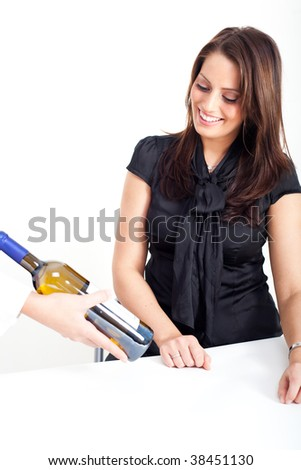Young woman, looking at a bottle of wine - stock photo