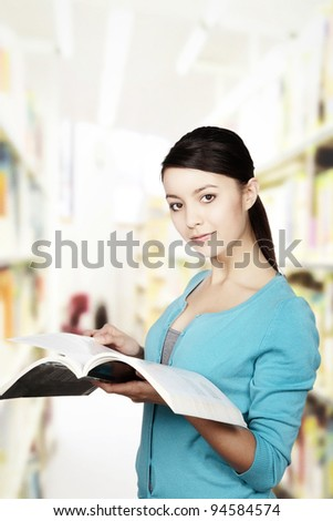 young woman looking at a textbook