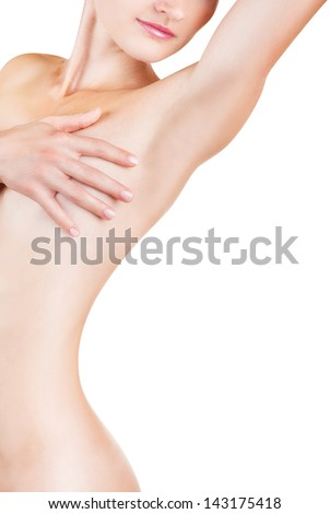 Young woman looking at her clean armpit isolated on white background - stock photo