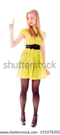 Young woman looking at her fingertip - stock photo