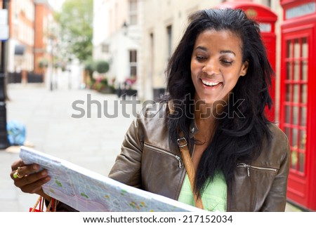 young woman looking at map in London - stock photo