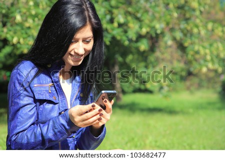 Young woman looking at phone and smiling