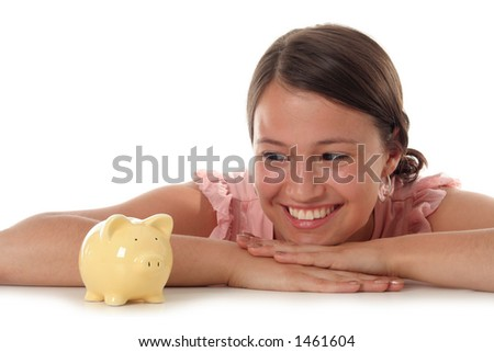 Young Woman Looking at Piggy Bank