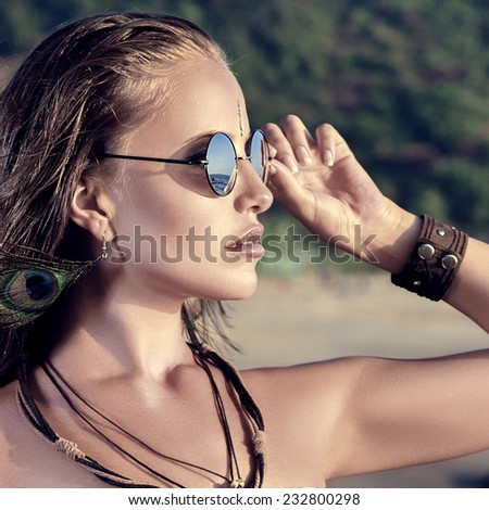 Young woman looking at sea. Sunset time outdoor portrait - stock photo