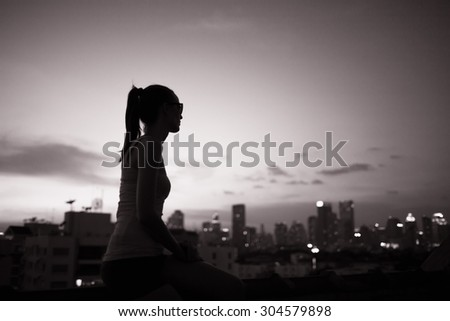Young woman looking at the city view. - stock photo