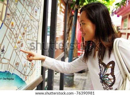 young woman looking at the map - stock photo