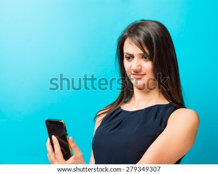 young woman looking at the phone, angry