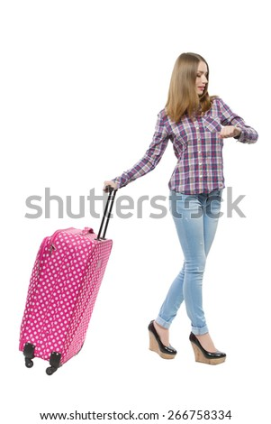 Young woman looking at the time and ready for travel. isolated over white background - stock photo