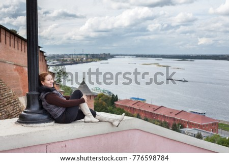 Young woman looking at wide open space of Volga river. The Nizhny Novgorod city, Russia
