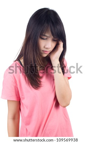 Young woman looking depressed with closed eyes - stock photo