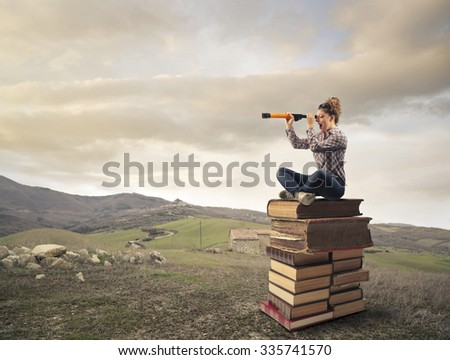 Young woman looking in the distance - stock photo