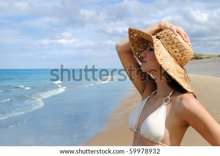 Young woman looking on the sea. England. - stock photo