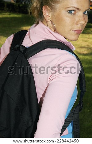 Young woman looking over shoulder - stock photo