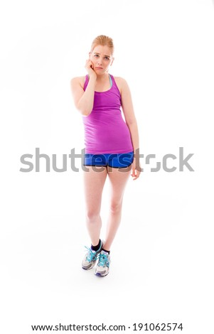 Young woman looking sad with her hand on chin - stock photo