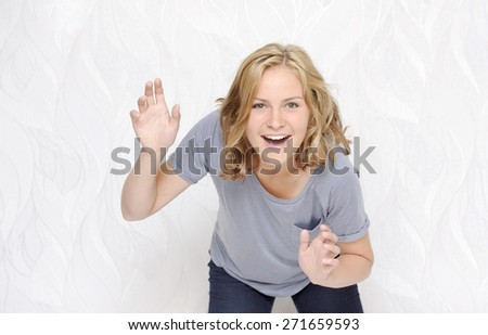 Young woman looking surprised on white background