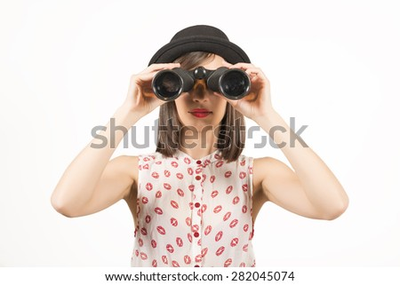 Young woman looking through a binocular, studio shot on white background. Keeping an eye on seals - stock photo