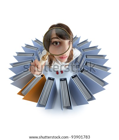 Young woman looking through a magnifying glass surrounded by office folders
