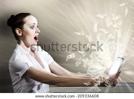 Young woman looking with surprise in tablet pc - stock photo