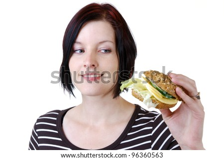 young woman looks at a bread roll