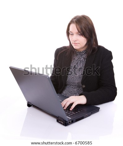 Young woman looks at her laptop