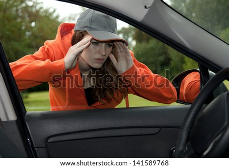 young woman looks to car through window, white background
