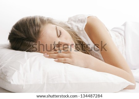 Young woman lying and sleep on the bed - stock photo