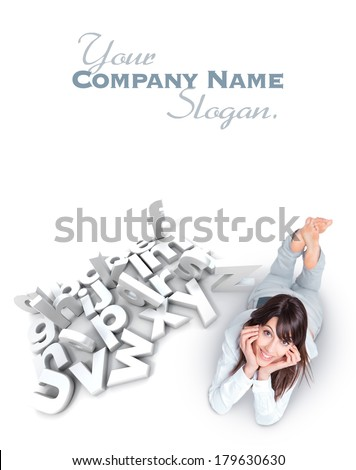 Young woman lying by a white alphabet with scattered letters - stock photo