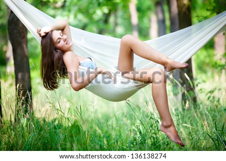 Young woman lying in a hammock on resort - stock photo
