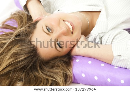 Young woman lying in bed