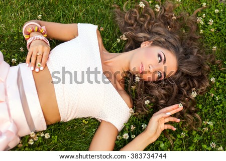 young woman lying on grass - stock photo