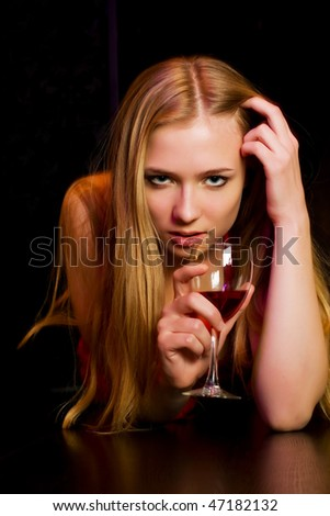 Young woman lying on the bar counter. - stock photo