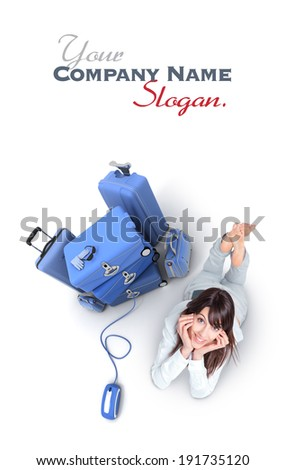 Young woman lying on the floor by a pile of luggage connected to a computer mouse