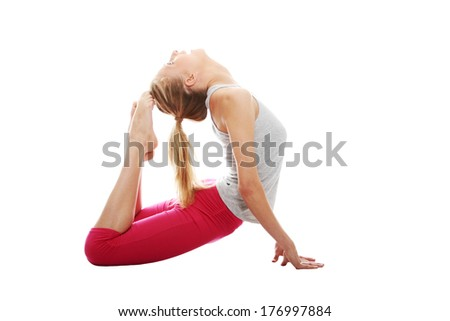 Young woman makes exercise isolated on white - stock photo