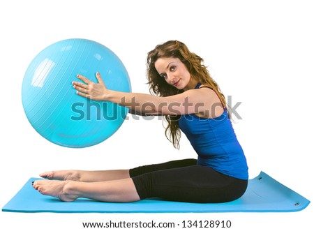 Young woman makes gymnastics on a blue mat