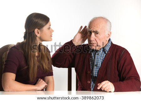 young woman makes hearing test for old senior man