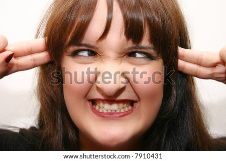 young woman making a funny face - stock photo