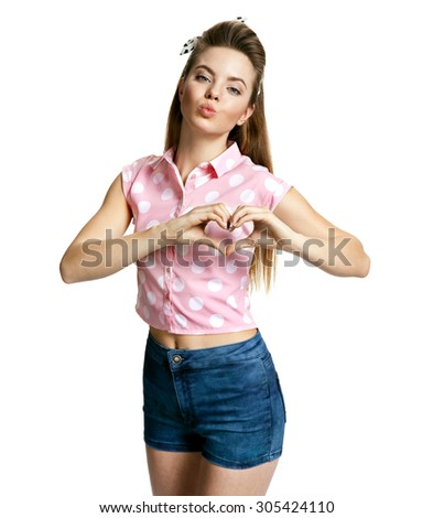 Young woman making a heart shape with her hands / photo of young cheerful brunette woman over white background, positive emotions - stock photo