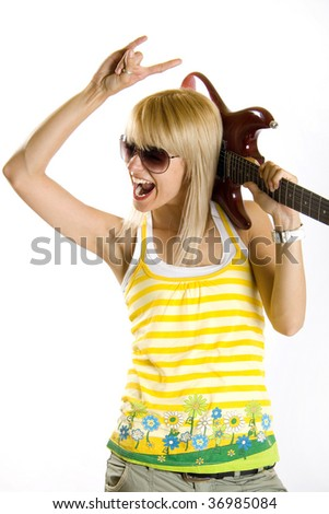 young woman making a rock sign with guitar on shoulder