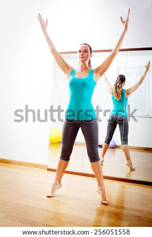 Young woman making fitness exercises stretching witn open arms