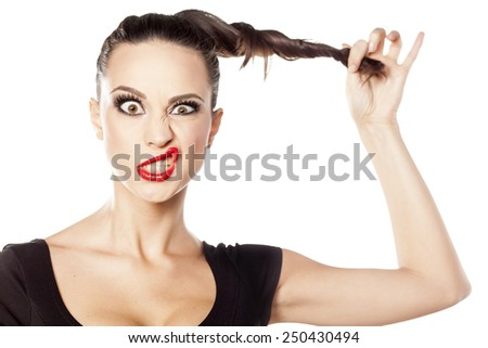 young woman making funny face - stock photo