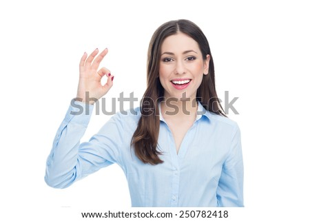 Young woman making OK sign  - stock photo