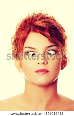 Young woman making squint - stock photo