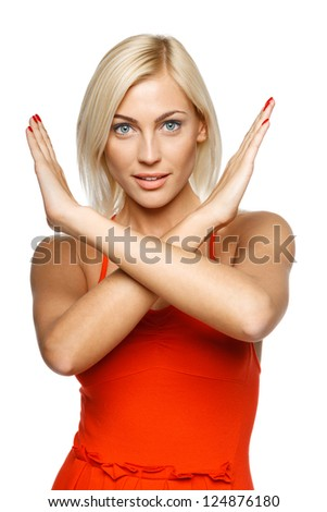 Young woman making stop gesture over white background
