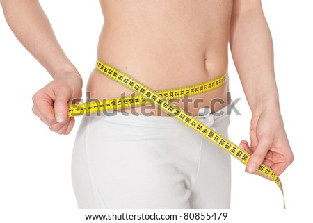 Young woman measures a volume of waist on a white background.  Concept of healthy lifestyle.