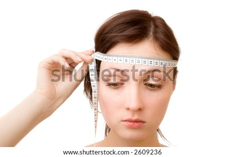 Young woman - measuring brain size (isolated on white)