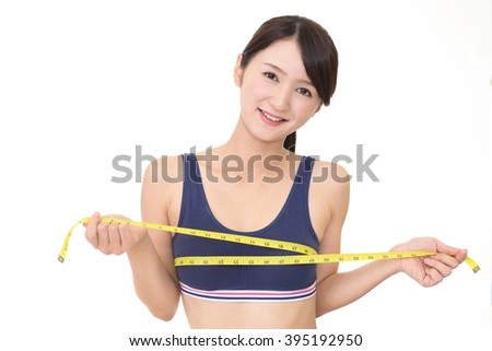Young woman measuring her breast - stock photo