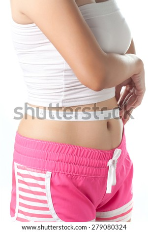 Young woman measuring her waistline with measuring tape, Beauty body care and diet - stock photo