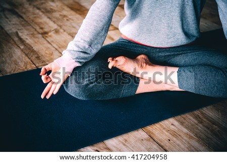 Young woman meditates while practicing yoga. Freedom concept. Calmness and relax, woman happiness. - stock photo