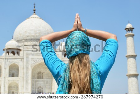 Young woman meditating atTaj Mahal. Agra, India - stock photo
